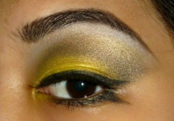 yellow makeup with black eyeliner